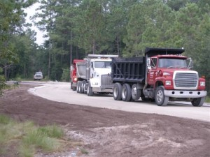 Trucks Prepare Road for Paving in Seawatch